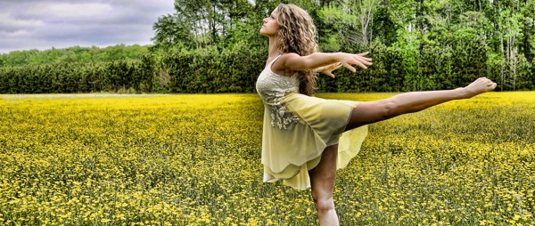 lady dancing in field