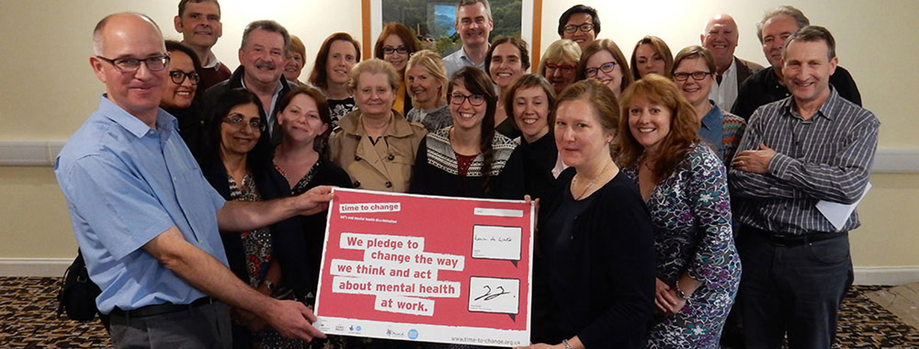 Voluntary Arts staff and board signing Time to Change pledge